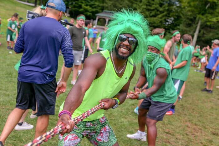 Trail's End Camp counselor takes part in Olympic Tug-o-war